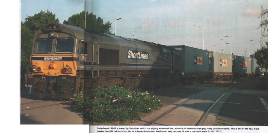 Porterbrook's PB02 is leased by Shortlines which has slightly enhanced the Union Pacific Harbour Mist grey livery with blue bands. This is one of the few 'base' liveries that GM delivers Class 66s in. It leaves Rotterdam Waalhaven yard on June 17 with a container train.